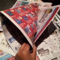 Fold a flyer into a cone shape and secure with tape (not glue).