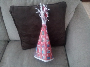 Finished festive Christmas hat - not too shabby. Looks vaguely like a party hat.