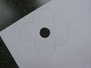 Colour in the black centre of the poppy