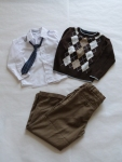 3-5 years - A very classic, Sunday-best look featuring a knitted argyle sweater.