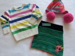 5-6 years - Bright and happy, we teamed a cable knit sweater with broad horizontal colourful stripes with a handmade bum warmer that picks up some of the same colours...and we topped it all with the biggest pom poms we could find on a hat!