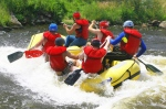 A team of people white water rafting