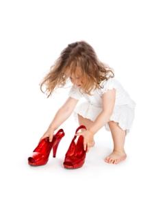 Girl wearing mom's heels